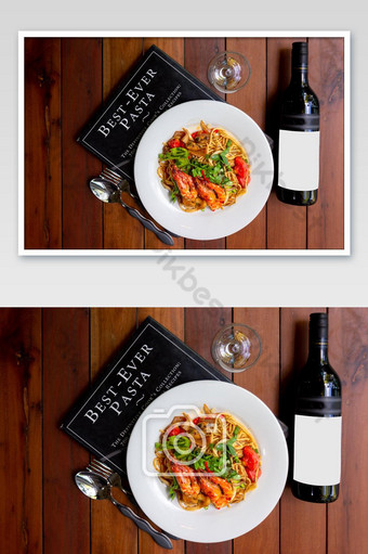 spicy seafood spaghetti pasta or Spaghetti tom yum with a bottle of wine, a fusion of Ital Photo Template JPG