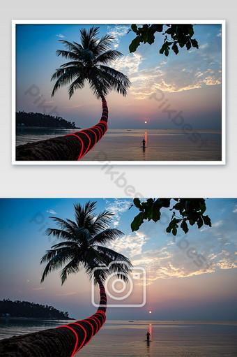 The beauty of coconut trees and tourists walking in the sea during sunset at Haad salad Be Photo Template JPG