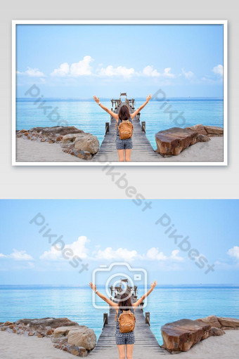 Women raise their arms and shoulder backpack on wooden bridge pier boat in the sea and the Photo Template JPG