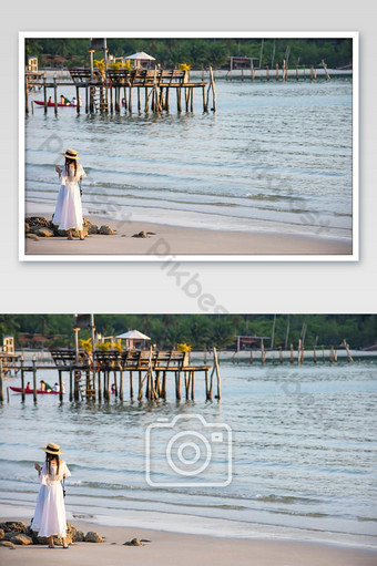 Asian woman playing phone on the beach Background sea and a wooden bridge at Koh Kood, Tr Photo Template JPG
