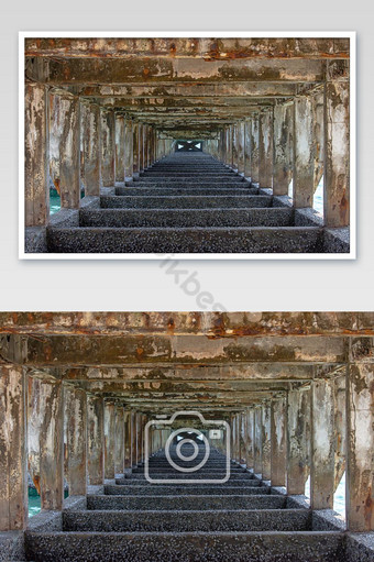 Structural concrete columns and beams under the bridge was damaged at sea. Photo Template JPG