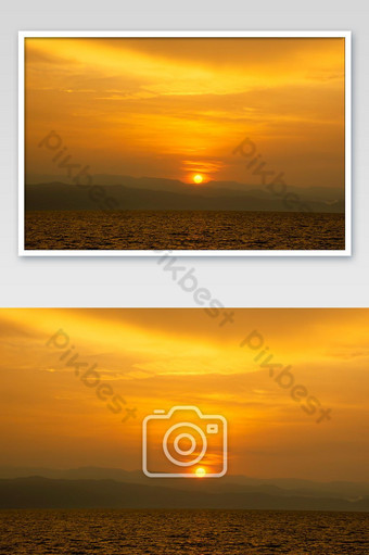 Golden light of sunrise behind the mountains and the sea. Photo Template JPG