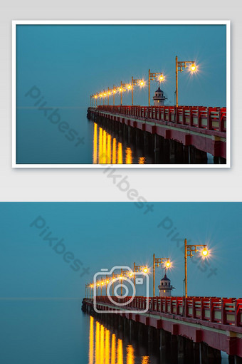 The lights on the bridge at night Background Sea at Prachuap Bay in Thailand. Photo Template JPG