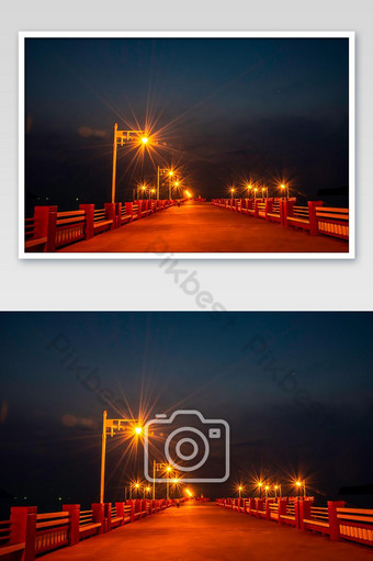 The lights on the bridge at night Background Sea and island at Prachuap Bay in Thailand. Photo Template JPG