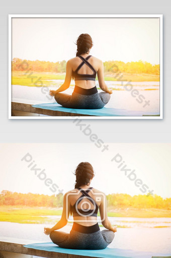 Young fitness woman practicing yoga on the field, healthy lifestyle concept. Photo Template JPG