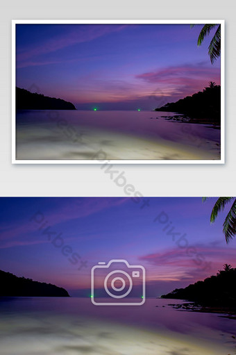The beauty of the sunset in the sea and the light from the fishing boat. Photo Template JPG