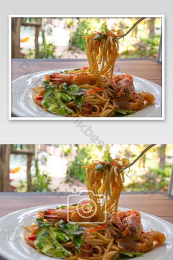 spicy seafood spaghetti pasta or Spaghetti tom yum with a folk Photo Template JPG