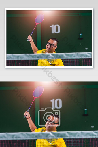 Man Asian badminton player serve action play badminton for training active exercise in sta photo Photo Template JPG