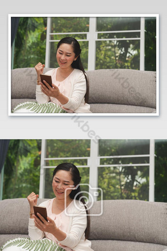 Happy senior glad looking stock market investment to success in smartphone at home photo Photo Template JPG
