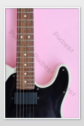 تفاصيل الغيتار الكهربائي على صورة خلفية وردية التصوير قالب JPG