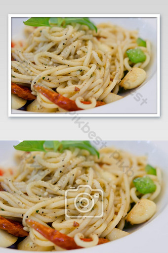 spagetti seafood spicy on wood table photo Photo Template JPG