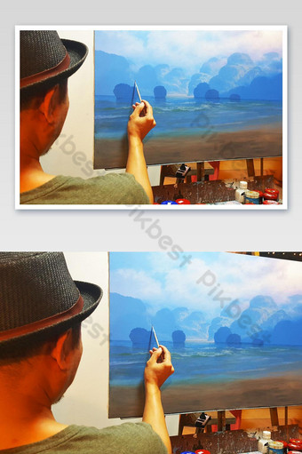 Men artist paints a picture sea in the night market at Hua Hin thailand photo Photo Template JPG