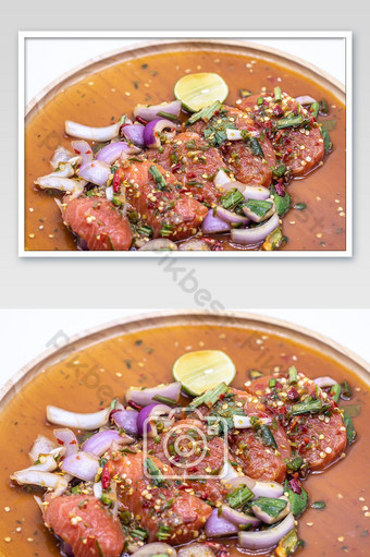 Thai spicy salmon salad in wooden plate isolated photo Photo Template JPG