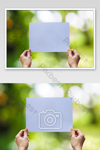 Mostrar papel comercial en la mano sobre fondo de naturaleza Fotografía Modelo JPG