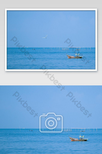 Fishing boats on the sea with blue sky background. Photo Template JPG