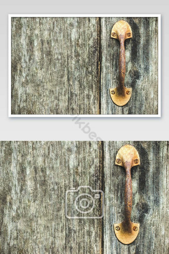 The vintage door handle rust on the wooden door of the old house. Photo Template JPG