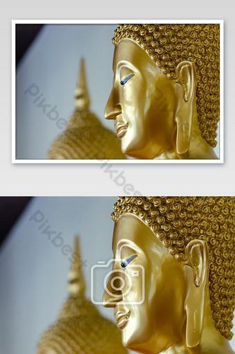 พระเศียรปิดทองที่ใช้เป็นเครื่องรางของศาสนาพุทธในประเทศไทย การถ่ายภาพ แบบ JPG