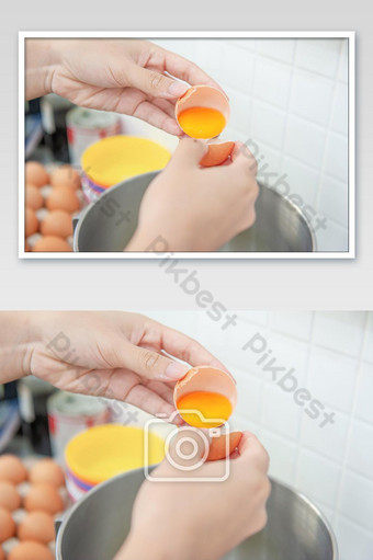 Woman hands to egg shells and separate egg yolk for made bakery ingredient and cooking. Photo Template JPG