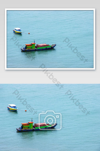 Traditional fishing boat and speed boat floating in the sea after send the tourists. Photo Template JPG